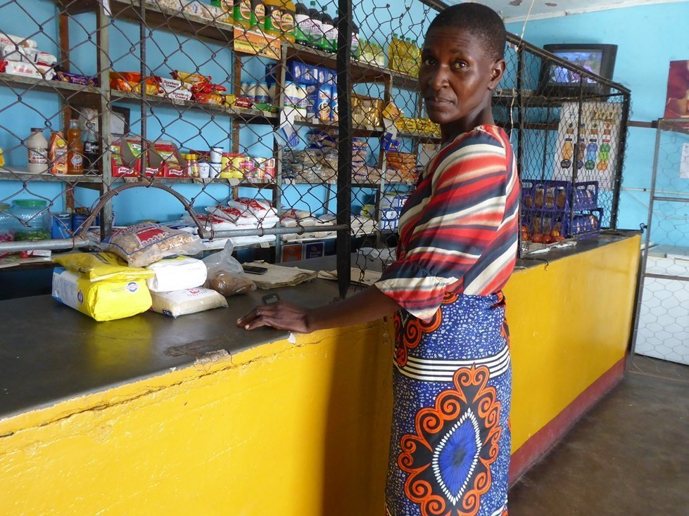 Mother of two, Letwin Chisorochengwe uses cash from CARE to buy food for her family in rural Zimbabwe