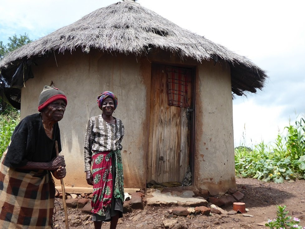 Susan and her mother Mazvipesa use cash from CARE to buy food, soap, seeds and to complete home repairs.
