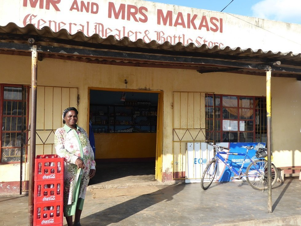 Clara Makasi is a shopkeeper in rural Zimbabwe. The goods she sells move faster since CARE has facilitated cash distribution in her community.