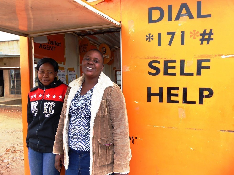 Dorothy Shumba (right), photographed with Fungai Hove started a cash agency businesses after CARE began distributing cash in rural Zimbabwe