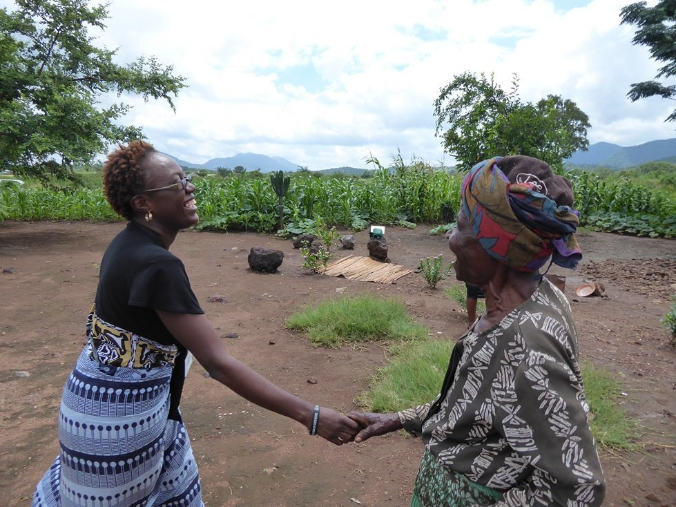 Patricia Mucheche (left), CARE's Accountability Officer for the Cash Transfer Project in rural Zimbabwe with recipient Susan Zidayauswa