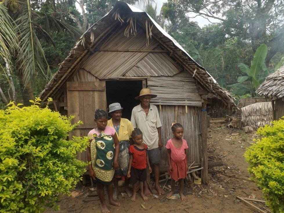 Three generations in a damaged house. Antalaha, Madagascar