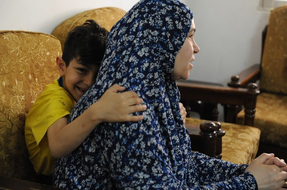 Hanna, 50, escaped the war in Syria with her five children, including Batul, 9 and Moutaf, 6.