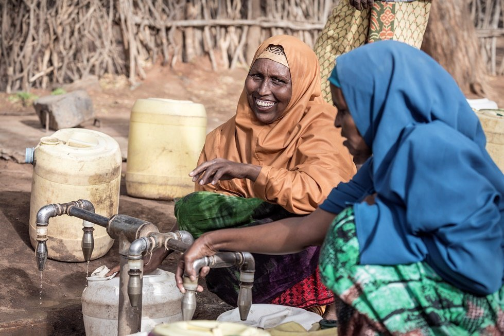 Photo: Sven Torfinn. Kenya, Dadaab refugee camp, February 2017.  Women fetching water at water points. CARE and ECHO are providing portable drinking water to hundreds of thousands of people in the world's biggest refugee camp.