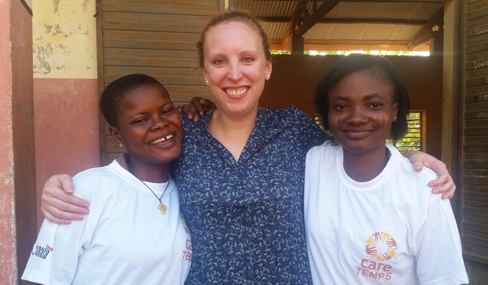 CARE's Evelyne Morin with girls from the TEMPS project in Benin