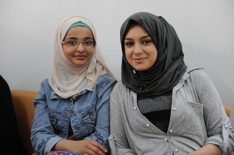 Yamama, 17, with her friend Shahed