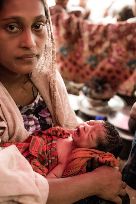 Maimuna and her infant daughter are refugees from Myanmar living in a makeshift shelter in a settlement in Bangladesh.