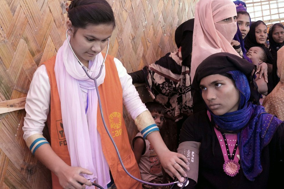 Senoara receives medical check up from CARE staff near Balukhali camp in Bangladesh