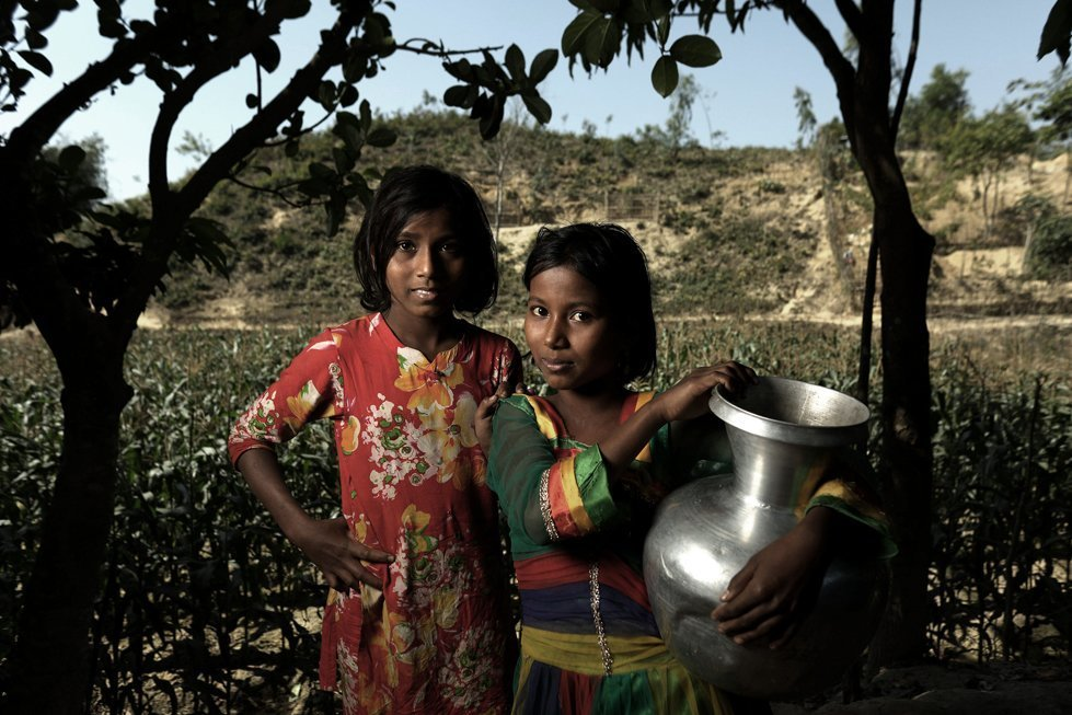 Somira and her sister Asia in a refugee camp in Bangladesh