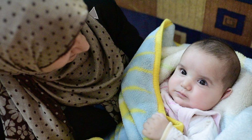 Fatmeh with her 5 month-old daughter, Layla