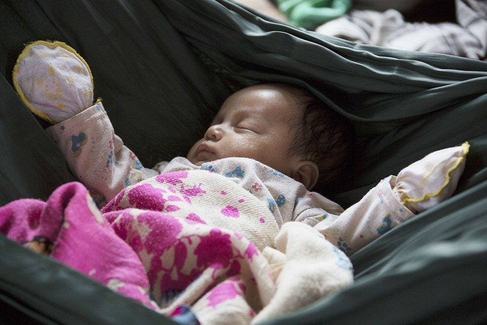 Sina's baby daughter, Davit, was born at a local health centre in rural Cambodia. Photo: Sok Vichheka/CARE