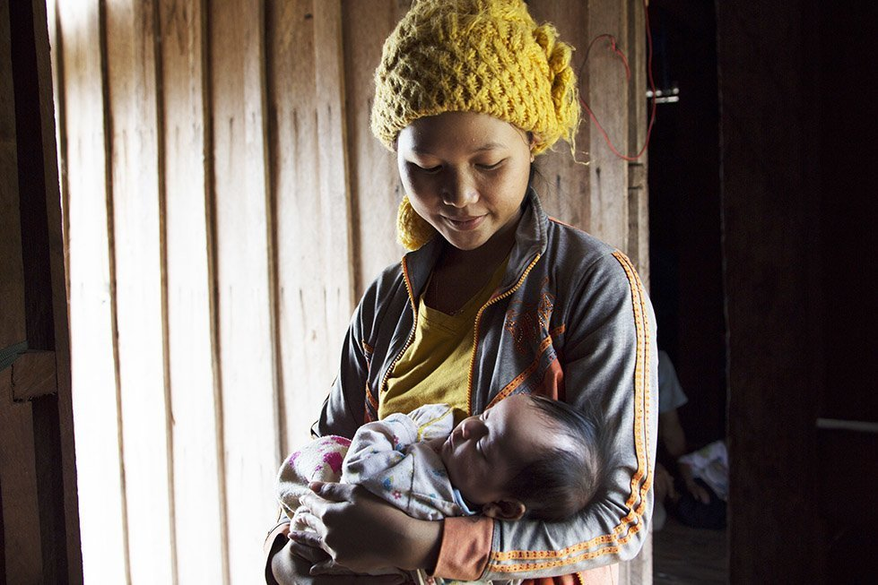 Sina and her baby girl, Davit. Photo: Sok Vichheka/CARE