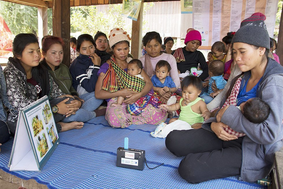 Women come together to listen to the radio show and discuss what they have heard. Photo: Sok Vichheka/CARE