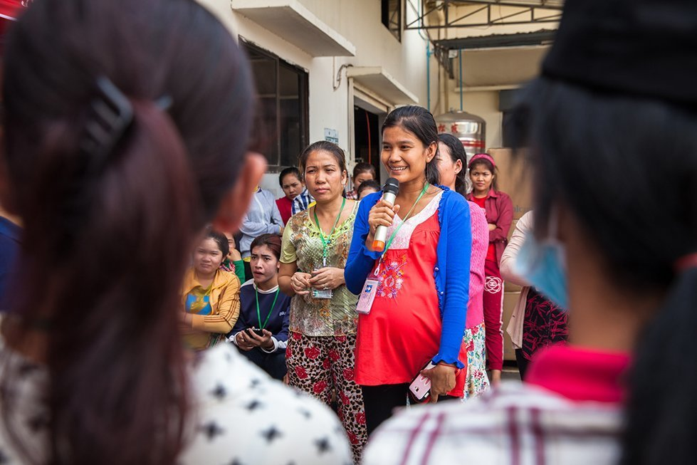 Maly participates during an outdoor contraception activity at a garment factory.