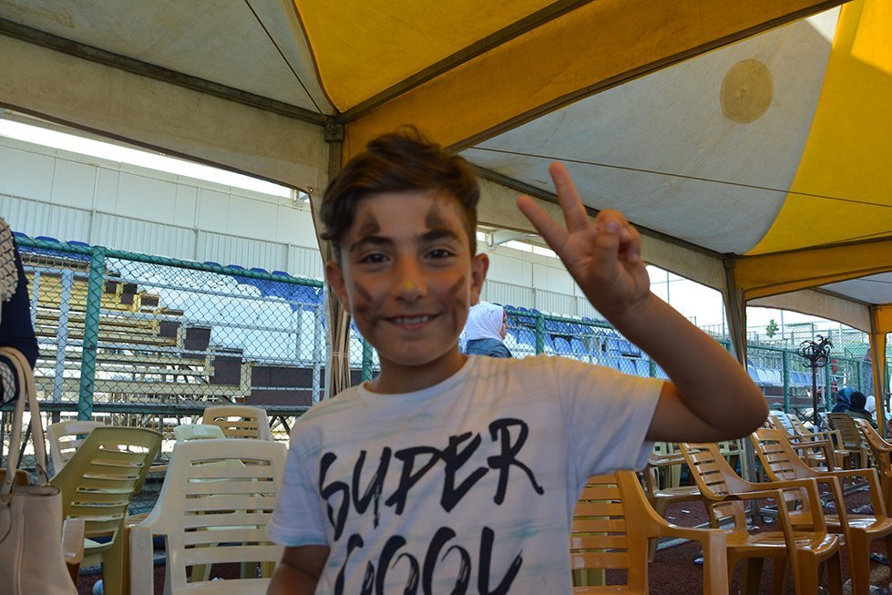 Hassan shows off his painted face during the children's festival in Kilis, Turkey.