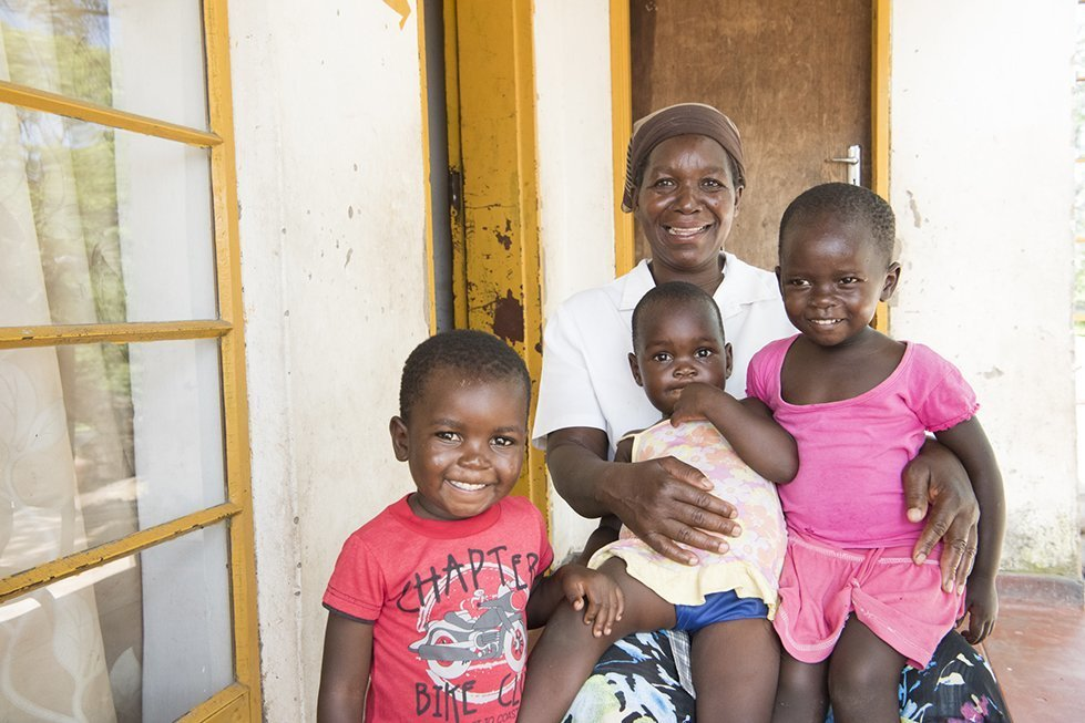 Susan with her grandchildren in their home in Chivi District, Southern Zimbabwe