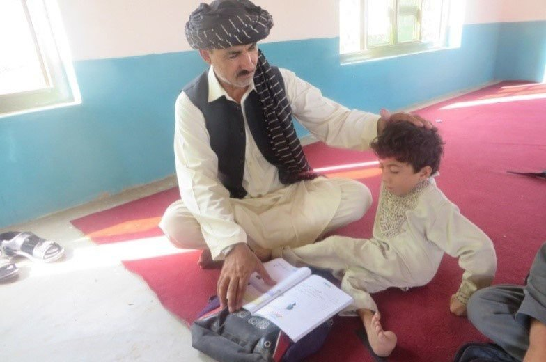 Sabirullah is 10 years old, from Afghanistan. He wants to be a teacher.