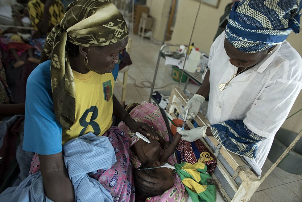 Staff at the hospital attend to a young child