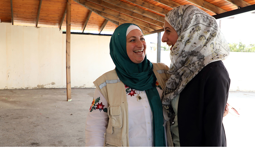 May with one of the women in the eco-farm co-op that CARE is supporting in the West Bank. Laura Banks/CARE