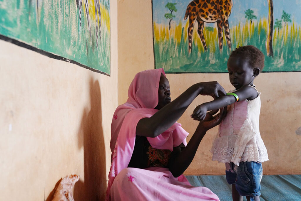 Zahara Tutu, 20, is measuring with her daughter Sima Braziz, 2, who is malnurished, at the nutrition center ran by CARE in the hospital in Yida, Ruweng State, South Sudan, on February 5th, 2021. Photo: Andreea Campeanu/CARE