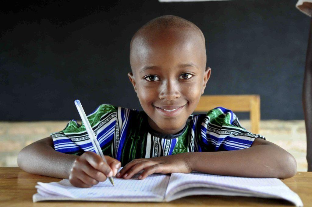 Student at her desk in Rwanda