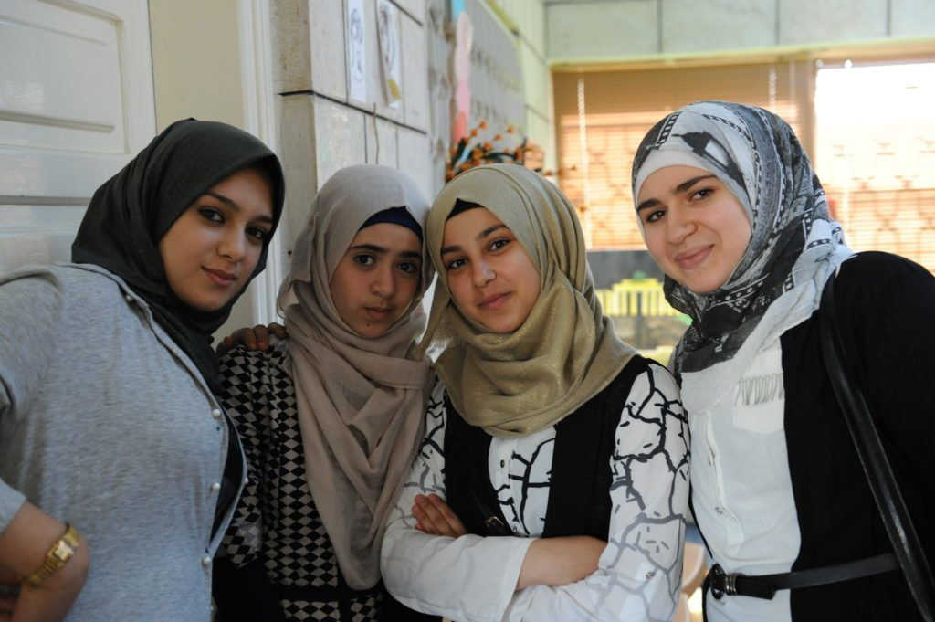 Syrian teens participate in peer to peer support groups in a CARE community centre in Irbid, Jordan. Part of CARE's psychosocial programming, teenage girls come together to discuss topics ranging from personal narrative to early child marriage, stress management to gender-based violence. Credit: Mary Kate MacIsaac/CARE