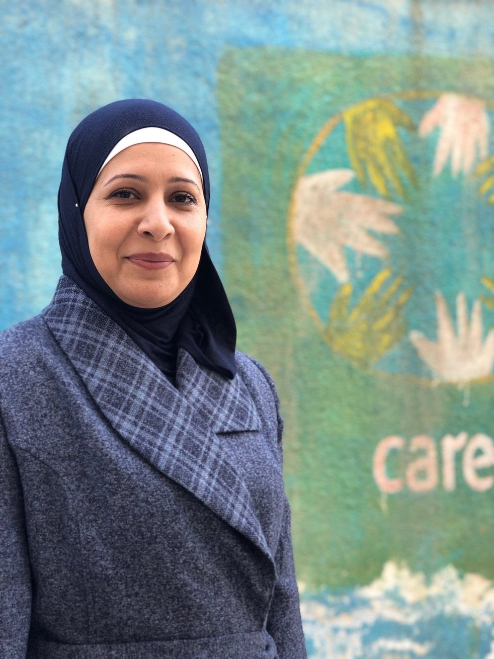 """<p style=""""margin-left:0in;margin-right:0in""""><span style=""""font-size:12pt"""">Emiline, 39, is a married Syrian mother of three. When she came from Syria to Jordan in 2012 with her husband and children, she found herself trapped inside four walls. She was too afraid to leave her home, and wouldn't let her children leave either. Her husband couldn't find work and they had no source of income. This turned their household into a place where no one felt happy, or even safe. """"I became a different person; I yelled at my kids, I stopped talking to my husband, and I locked myself in a room most of the time. The walls were closing in on me,"""" explains Emiline.</span><span style=""""font-size:12pt"""">""""The first session I ever attended was at CARE, and it was about <em>Women's Rights</em>. I remember going back home and telling my husband to take us back to Syria if this was how we were going to continue living. I have rights, and I want to be able to live like everybody else. The next session I attended was about <em>Child Abuse</em>. I was heartbroken to know that my attitude and feelings were directly affecting my children.""""</span><span style=""""font-size:12pt"""">Emiline did not stop working to improve her life. Eventually she became one of the leaders at CARE's Zarqa Women Leadership Council. """"I now stand and talk to other women from a hurtful experience. I tell them that I was exactly where they are now, and show them that I'm a live example of how things improve when you are determined to be better. My husband and children are so proud of me. I'm proud of myself."""" </span></p>"""