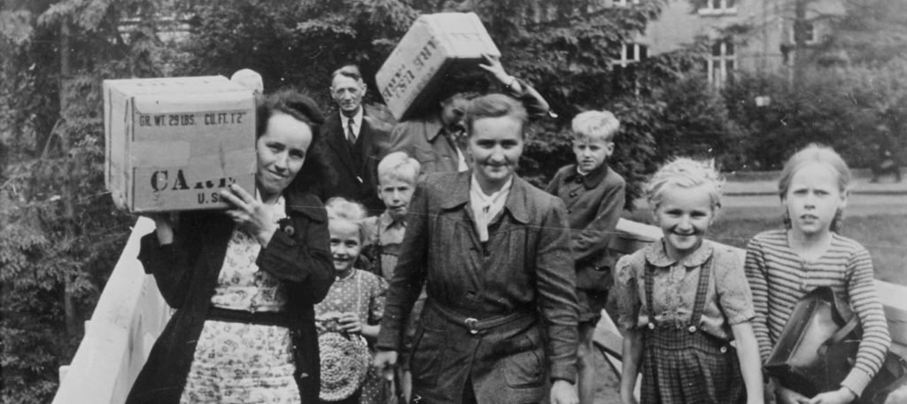 People carrying CARE packages in Germany