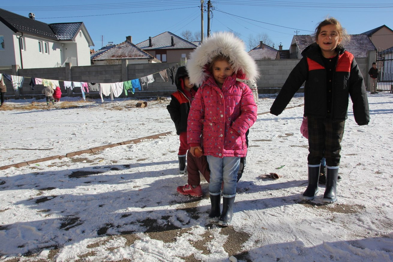 Refugee children playing in the snow in Sjenica