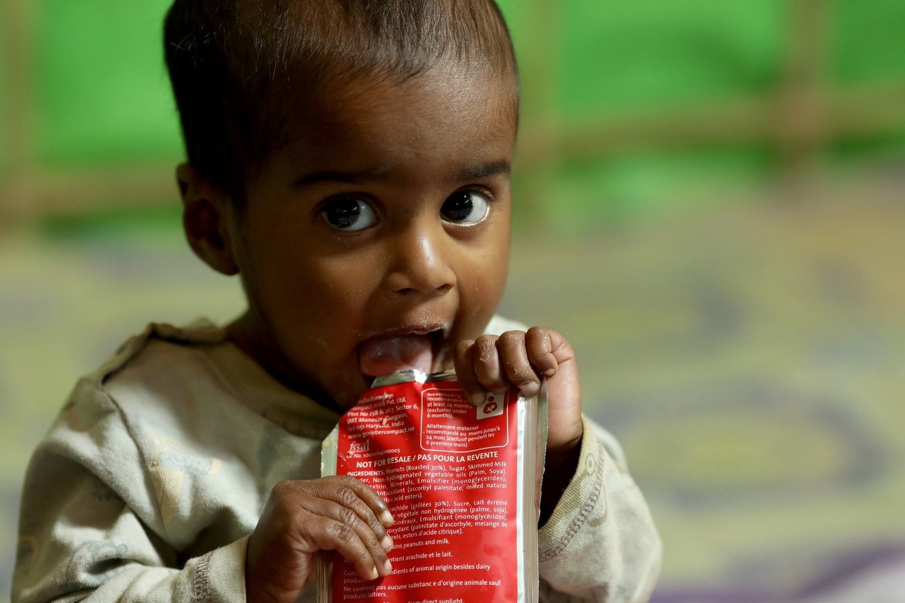 Yasmin eats Plumpy nut, a high-protein food to help malnourished children
