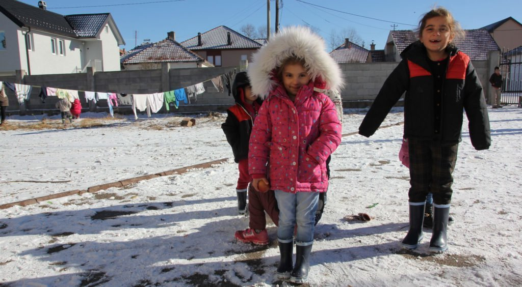 Syrian children play in the snow in a temporary shelter for refugees in Sjenica, Serbia