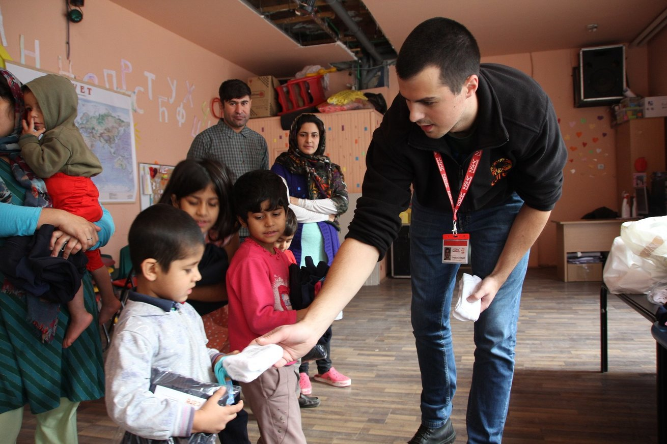 Distribution of winter clothes to refugees in Bogovadja, in Western Serbia. 240 people are housed in a refugee camp here where CARE's partner NSHC provides ongoing support. Today, families receive a CARE package of different items including warm jackets, pants, sweatshirts, gloves, bonnets, underwear and other items to keep them warm during the winter.