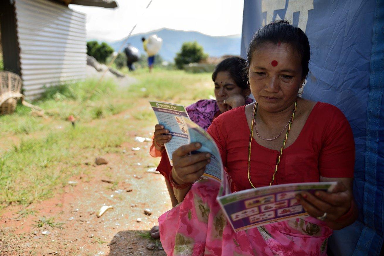 Women read brochures on water, sanitation and hygiene in Nepal