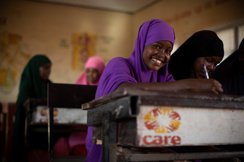 CARE in Somalia school girl at desk