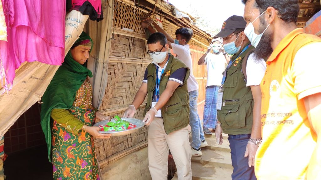 CARE staff in Cox's Bazaar distributing supplies