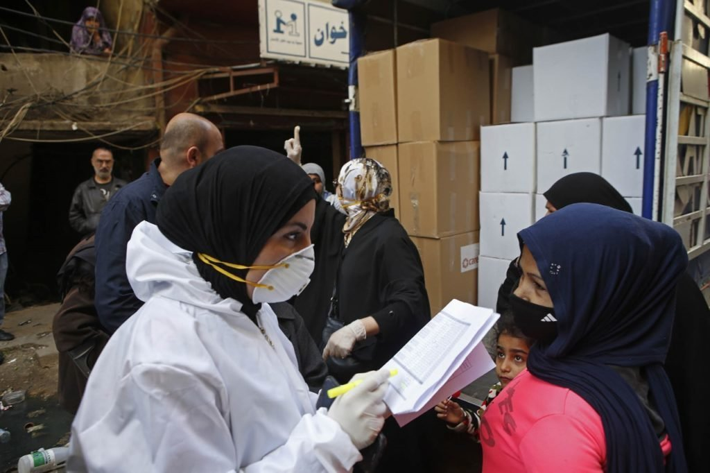 CARE staff fill vans with food parcels and hygiene items, in partnership with Lebanese NGO Sanabel al-Nour. CARE distributed food and hygiene packages to 300 vulnerable families in Tripoli, Northern Lebanon.