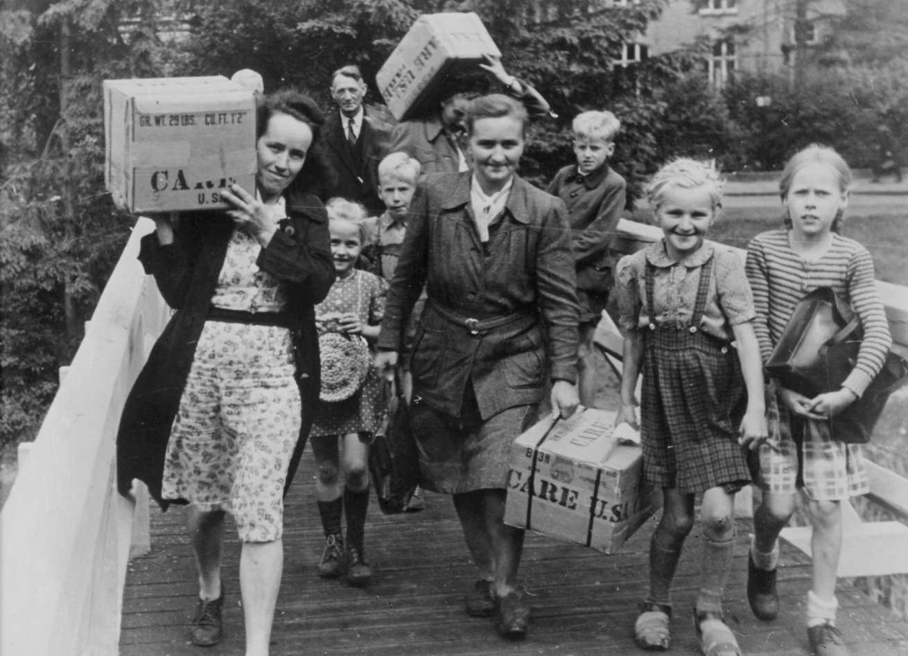 People carrying CARE packages