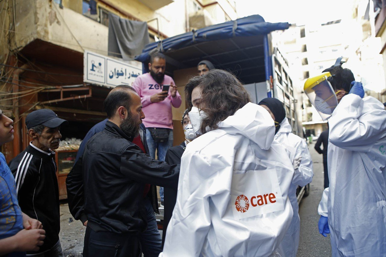 As part of CARE's response to COVID-19 in Lebanon and to prevent further spread of the virus, CARE staff fill vans with food parcels and hygiene items, in partnership with Lebanese NGO Sanabel al-Nour.
