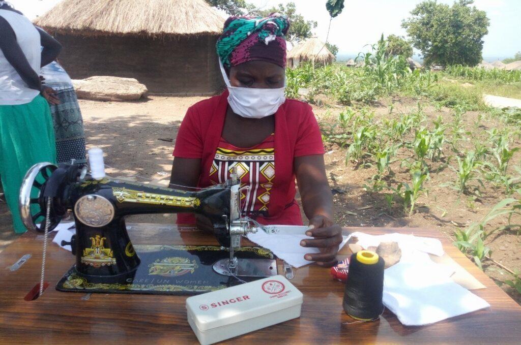 Refugee women making masks in Uganda