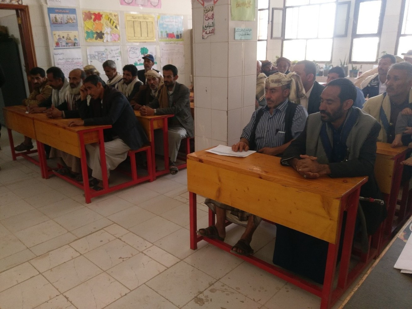 Stakeholders discuss educational change during a dialogue session at Al-Hareth school
