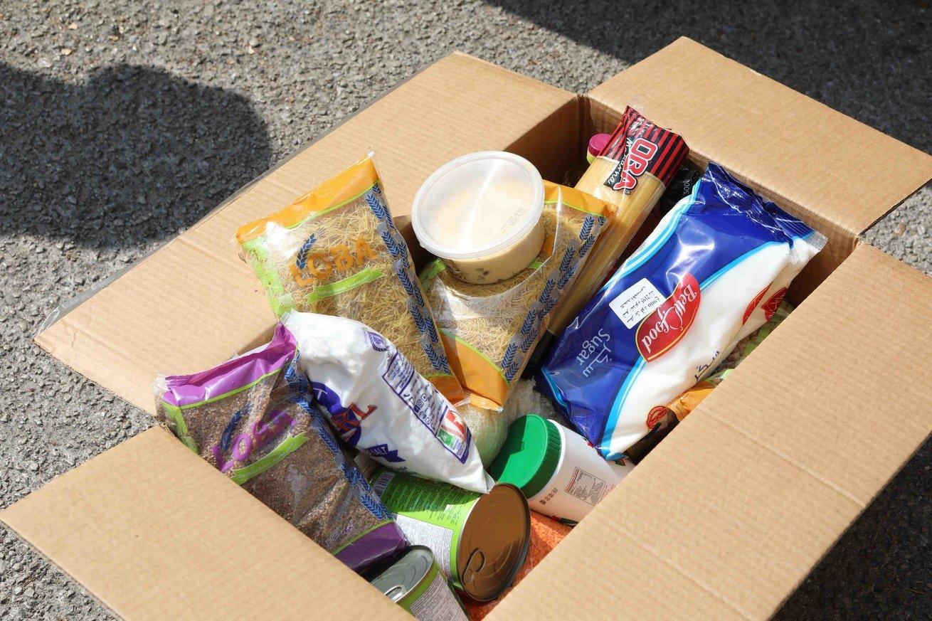 CARE is distributing hot food, food basket