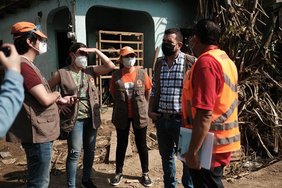 CARE staff assembles to assess Eta's damage in El Calan, Villanueva, Cortes, in the country's northern region.