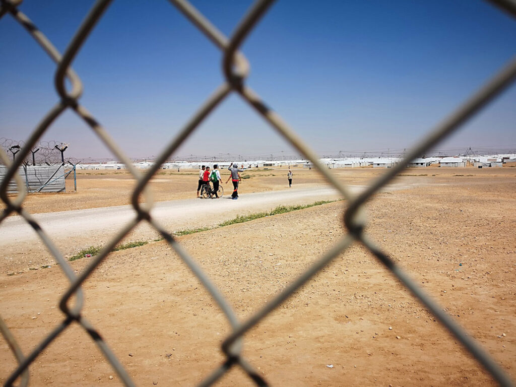 In the heart of the Jordanian desert, the camp is home to over 35,000 Syrian refugees. 60% are children and 1 in 4 households are headed by women. About 19 refugees arrive to the camp daily. The camp is classified in 4 villages, each one with a Community Center, a Health Center and a school. CARE manages all four community centers of the camp, acting as the hub organization and as a one-stop-shop that refugees visit daily for all their hanging matters and needs. Each center receives between 500-700 people each day. CARE provides recreational and psychosocial support activities, livelihood support and vocational training, cash assistance as well as referrals. Photo: Katharina Katzer/CARE