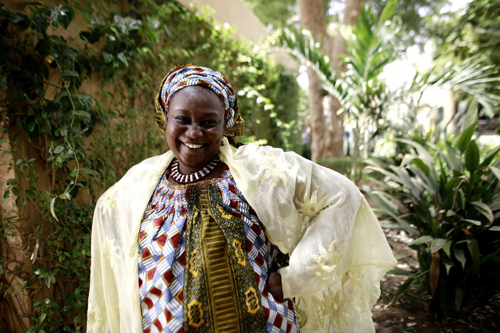 Salamatou Dagnogo was stranded in Niger after her abusive husband put her on a bus, knowing she would not have enough money to return to Côte d'Ivoire. In Niger, she joined a Village Savings and Loan Association (VSLA), a co-op that allows women to be their own bankers. After 18 months, Salamatou used her earnings to purchase a bus ticket back to Côte d'Ivoire where she was reunited with her children. Photo by Josh Estey/CARE