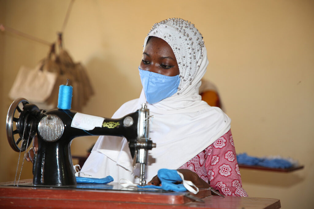 The pandemic has worsened the situation for many of the women in the Djekafo VSLA in Ségou. When the crisis broke out, the CARE team's priority was how to support the women and girls that could be affected. While other NGOs were preparing to buy and to import masks, CARE (through the GEWEP Project) was able to initiate the manufacturing of masks locally. The existing centres were put to use and professional tailors have been recruited by CARE to train women and girls in manufacturing the masks. CARE has been helping with the materials and production, as well as finding partners and customers. Photo: Elim/CARE Mali