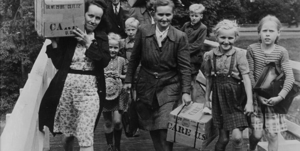 People with CARE Packages® in Germany after the Second World War. ©CARE