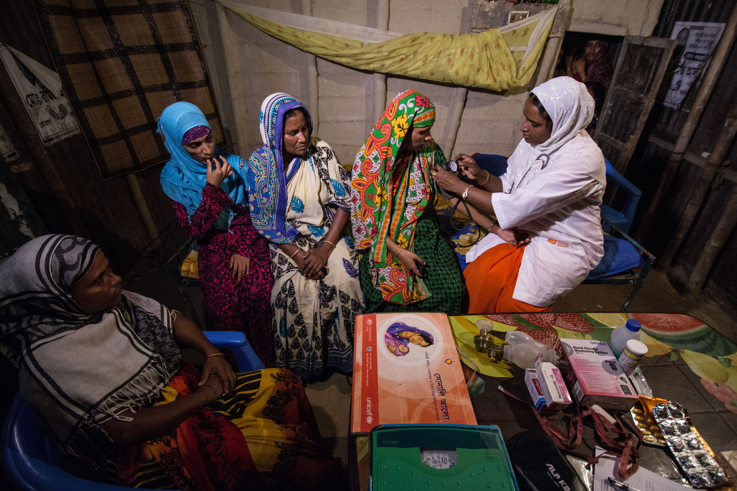 A community health worker with a group of women in Bangladesh.
