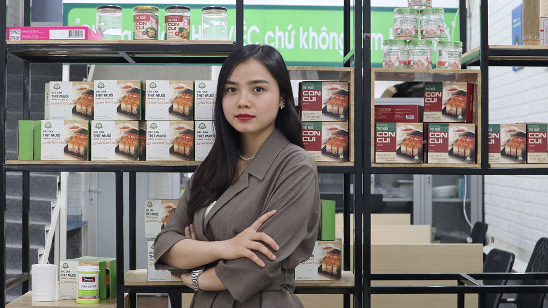"""<p style=""""margin-left:0cm;margin-right:0cm""""><span style=""""font-size:11pt"""">Nguyen Thi Hien from Hanoi is taking the business world by storm, despite her young age.&nbsp; Five years ago, at the age of only 21, Hien, together with her cousin, took over the family food business &lsquo;Truong Foods&rsquo; from her aunt. The family has been producing and trading specialist pork products for almost 20 years.</span></p>  <p style=""""margin-left:0cm;margin-right:0cm""""><span style=""""font-size:11pt"""">Since taking over the business, Hien has established the business in both Phu Tho province and in the capital Hanoi.&nbsp; Between the two locations she now employs 15 office staff, as well as around 30 seasonal workers. </span></p>  <p style=""""margin-left:0cm;margin-right:0cm""""><span style=""""font-size:11pt"""">As the new Managing Director, Hien decided to formalize the business, she explains: &ldquo;Shifting from a household business model into a formal enterprise was the first barrier I had to overcome. We had to change our business activities to comply with the Government&rsquo;s regulations. Moreover, all procedures, such as human resources management and business operations, were subject to a total change, and we had to start from the beginning.&rdquo;</span></p>  <p style=""""margin-left:0cm;margin-right:0cm""""><span style=""""font-size:11pt"""">Hien also wanted to increase production so that they could diversify and expand their reach beyond the local market.&nbsp; Hien adds: &ldquo;When taking over the business I had to find ways to distribute more products to outside markets, while competing with other brands and products.&rdquo; Hien found it a challenge to be a woman selling products targeted at male customers, adding: &ldquo;Our products are targeted at beer shops and restaurants whose customers are mostly men.&rdquo;</span></p>  <p style=""""margin-left:0cm;margin-right:0cm""""><span style=""""font-size:11pt"""">Whilst Vietnam is moving towards a more gender equal society and there is now less pre"""