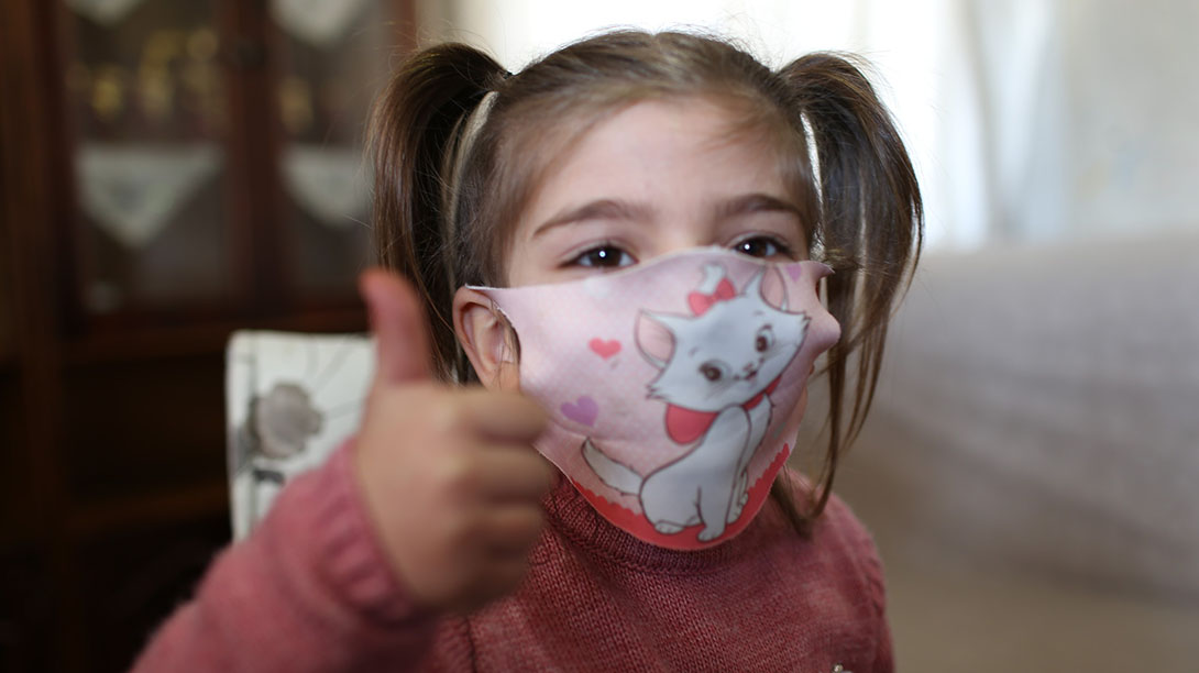 """<p style=""""margin-left:0cm;margin-right:0cm""""><span style=""""font-size:11pt""""><strong>Loujain, a Syrian refugee in Turkey, Encourages Children to Wear Masks</strong></span></p>  <p style=""""margin-left:0cm;margin-right:0cm""""><span style=""""font-size:11pt"""">Like many mothers, Loujain was worried about her three daughters and wanted to protect them from COVID-19. One day, she thought of using her experience in printing to make masks with her daughters&rsquo; favorite cartoon characters, to encourage them to wear masks. &ldquo;My daughters loved the characters and started wearing their masks at every suitable opportunity. The idea became popular among my friends and I began receiving orders to produce customized masks,&rdquo; Loujain says.</span></p>  <p style=""""margin-left:0cm;margin-right:0cm""""><span style=""""font-size:11pt"""">In a small room in her apartment with a computer, printing machines, and printed mementos, Loujain runs her printing business. When she studied English Literature in Syria to become a teacher, Loujain never imagined that she would run her own business as a refugee living in Turkey.</span></p>  <p style=""""margin-left:0cm;margin-right:0cm""""><span style=""""font-size:11pt"""">Loujain made many friends and developed a wide network of relationships in the refugee community in Nizip, southern Turkey. This network helped her to volunteer with CARE as a Community Activator. Since becoming a Community Activator, Loujain has provided awareness sessions for women on protection topics, child labor, early marriage, and benefitting from CARE&rsquo;s legal consultation services in Turkey. Through her work, Loujain has become a mentor and role model to the women she supported.</span></p>  <p style=""""margin-left:0cm;margin-right:0cm""""><span style=""""font-size:11pt"""">Four years ago, after her husband fell ill and had to stop working, Loujain started thinking of creative ways to support her husband and secure an income for her family. &ldquo;I thought of a business idea, where I could em"""