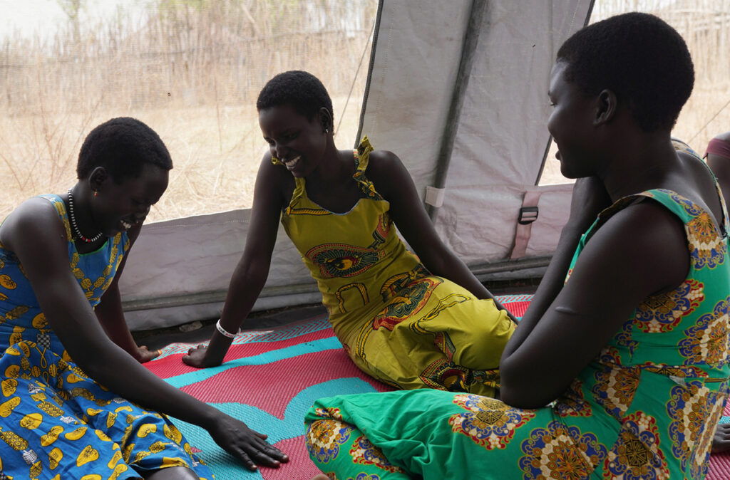 Adolescent girls chatting at their weekly meeting at the Women and Girls friendly space Center in Borin Bor, South Sudan. Credit: Campeanu 2021